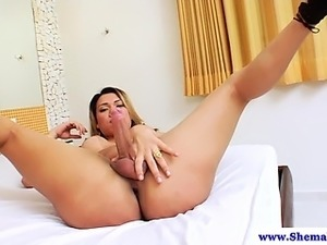 Solo ladyboy tugs cock and fingers ass