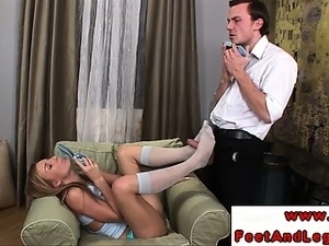 Sexy foot fetish babe in stockings sucks on cock