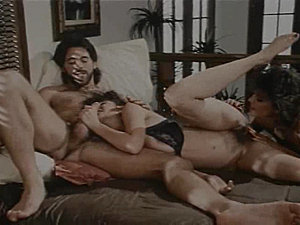 Retro brunette babe Christy Canyon finds herself the center of attention in a...