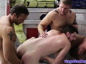 Gay firefighters polishing the knob