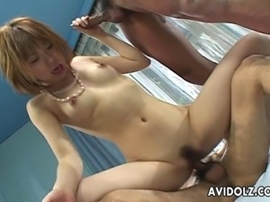 Provocative Japanese cutie with small natural boobs moans while her pussy is...