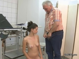 The skinny brunette lies down and spreads her legs for the doctor to give her...