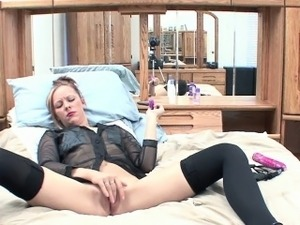 Blonde housewife Penelope Sky fucks her pussy with a toy