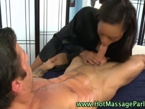 Sexy black masseuse babe sucks and jerks clients cock