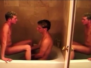 Sexy boys in the bathtub sucking toes and each others dicks