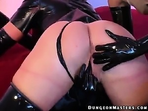 Superb lesbian slave in latex Petova gets pussy licked by a ponytailed mistress
