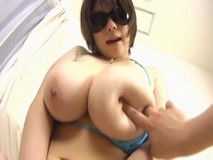 Big tits asian posing in blue bikini her natural giant tits