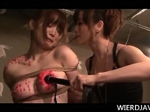 Jap mistress in latex spanking and dripping wax on a sex slave