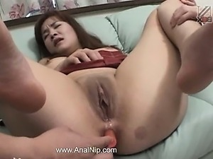 Toys in her tiny asian anal cunt