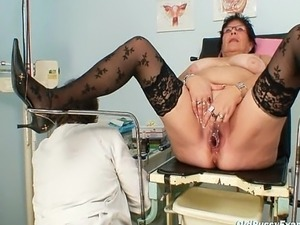 Kinky gyn doctor examines big mature woman who got big tits and wear glasses....