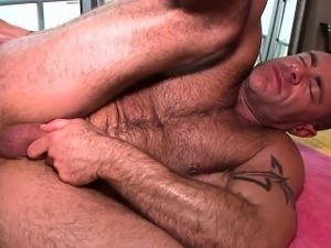 Cute homosexual man is given a lusty spooning during massage