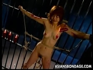Skinny Japanese chick tied up and drenched in hot wax free