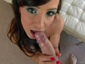 Busty Lisa Ann is a charming dark haired woman with