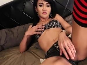 Ladyboy trans in long socks wanks her dick