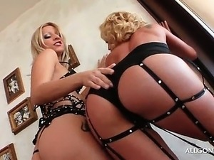 Lustful lesbian blondes sensually touching each other