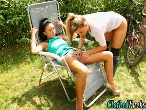 Clothed european glamour lesbians eat and finger pussy outdoors