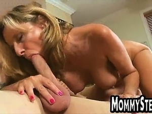 Tan blonde with big tits gives a blowjob