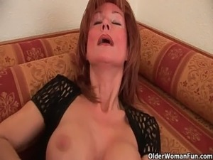 Sultry senior lady is toying her meaty pussy free