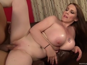 As soon as he sees his masseuse for the day, incredibly busty redhead Desiree...