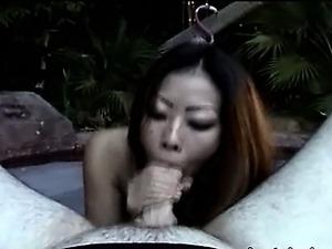 Asian pornstar in bikini smoking at pool