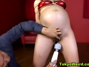 Watch this tied up japanese pregnant hoe getting pussy toyed