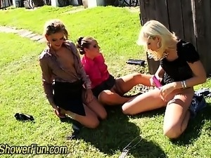 Lesbians pissing outdoors in threeway