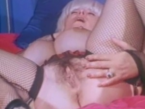Big boob vintage babe Candy Samples is wearing mesh lingerie during her...