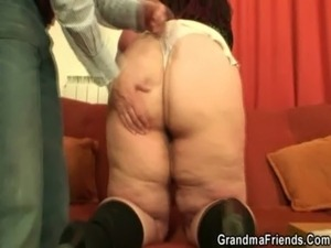 Older plumper takes two cocks free
