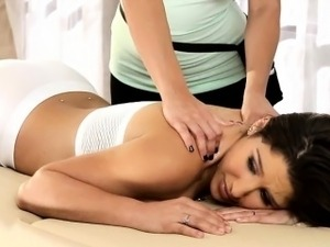 Lesbian massage turns into clit to clit fucking on the table