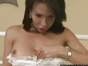 Brunette tranny babe gets naked and tugs her cock