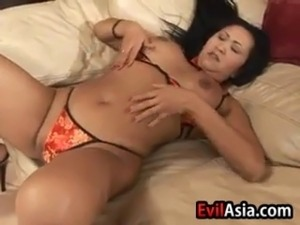 Asian woman wearing high heels playing with her loose pussy