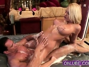Sexy supple blonde babe with huge boobs gives soapy massage