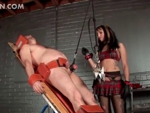 Kinky dominating slut tying up her sex slave and torturing his penis