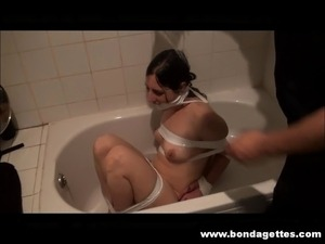 Bath bondage of roped and gagged Honesty in kinky domination and restraining...