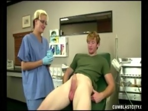 Horny doctor takes advantage of her patient by stroking his hard cock free