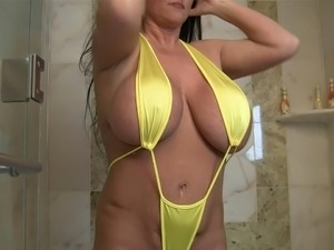 Milf with Huge Boobs Indianna Jaymes strips out Bikini