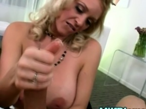 Big titted blonde milf housewife gives pov tit job