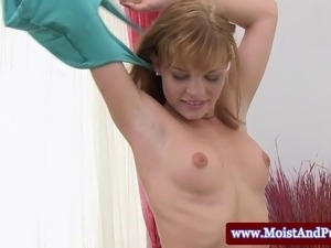 Puffy peach hottie having fun with a toy and spreading with a speculum