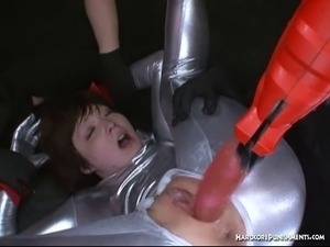 Silver full body suited teen fucked with fucking machine