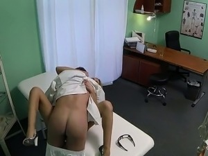 Doctor vibrates pussy of blonde in fake hospital