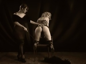 Vintage black and white fetish stage show