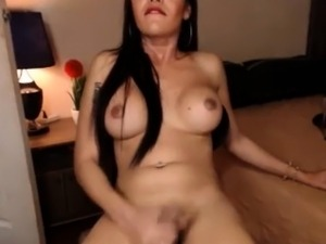 Brunette SheMale ejaculates a big Cumshot