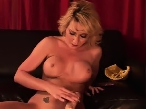 Busty blonde uses a machine to fuck herself
