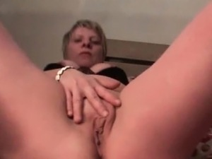 Slutty mature loves masturbating her pussy