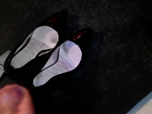 cumming in a patent leather pumps