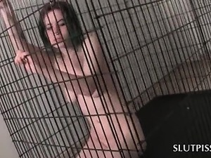 Naked caged piss slave getting spanked