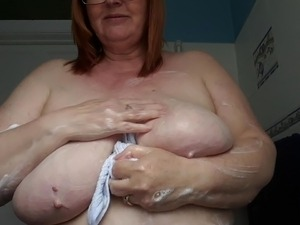 sparkling washes her big breasts