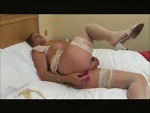 Mature shemale pleasing herself with a dildo