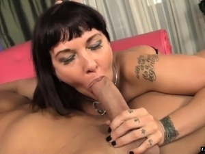 Buxom milf in fishnet stockings Carrie Ann licking a young man's butt