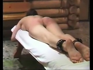 Flogging slave Laura in a sauna
